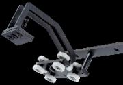 Tažné vozíky TT1 <br>jsou stejně jako pojezdy vybaveny dvěma vodicími kladkami. Čtyři opěrné kladky s kuličkovým uložením navíc zajišťují lehký chod i tehdy, když se při použití obkročovačů vyskytnou klopné síly.